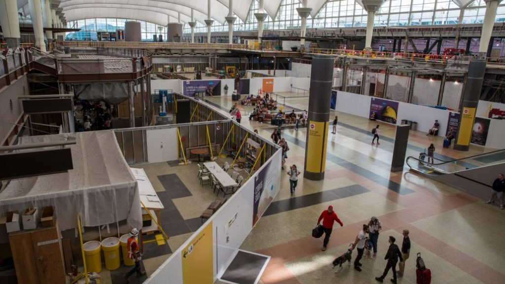 Passengers and visitors to Denver International Airport find themselves navigating a lot of detours as they check in or pick up baggage Friday June 28 2019. (Hart Van Denburg/CPR News)