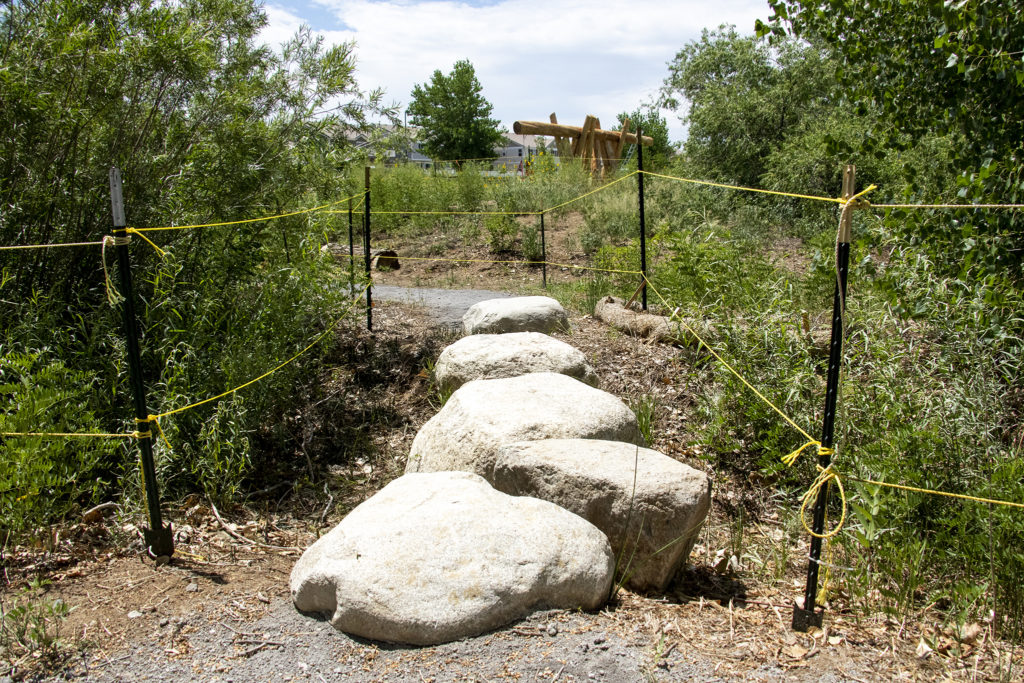 Stepping stones over a creekbed at the First Creek Natural Playground in Denver's DIA neighborhood, Aug. 1, 2019. (Kevin J. Beaty/Denverite)