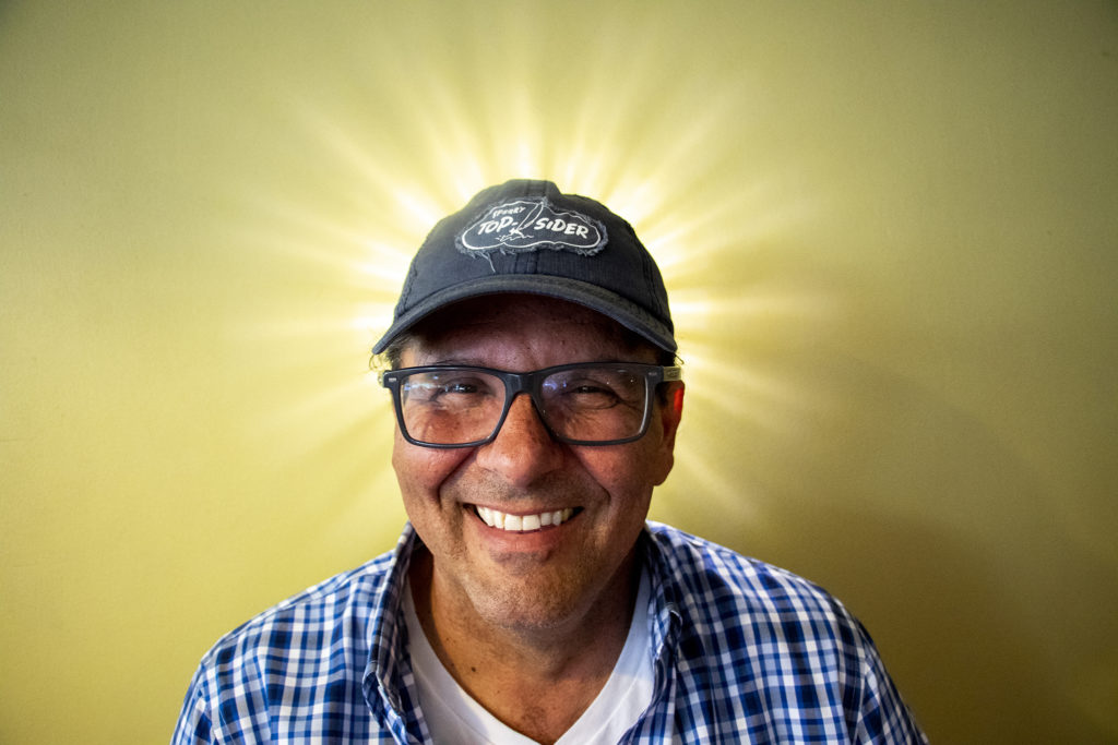 Tom Messina poses for a portrait inside Tom's Diner on East Colfax Avenue, North Capitol Hill, Aug. 15, 2019. (Kevin J. Beaty/Denverite)