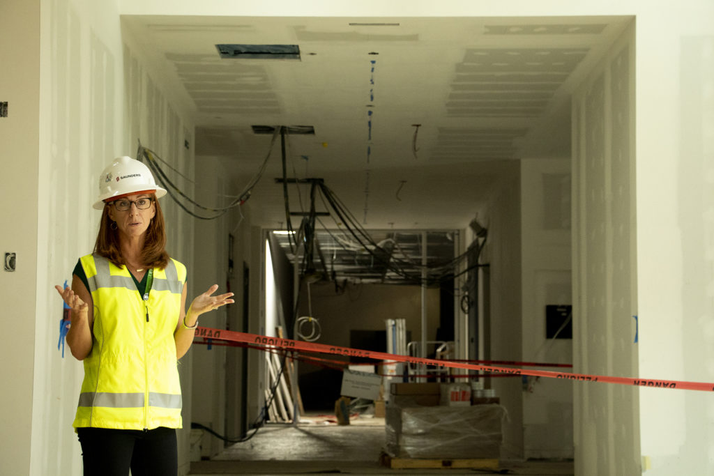 Andrea Kalivas Fulton, the Denver Art Museum's deputy director and chief marketing officer, leads a tour of the Denver Art Museum's new campus during construction, Aug. 8, 2019. (Kevin J. Beaty/Denverite)