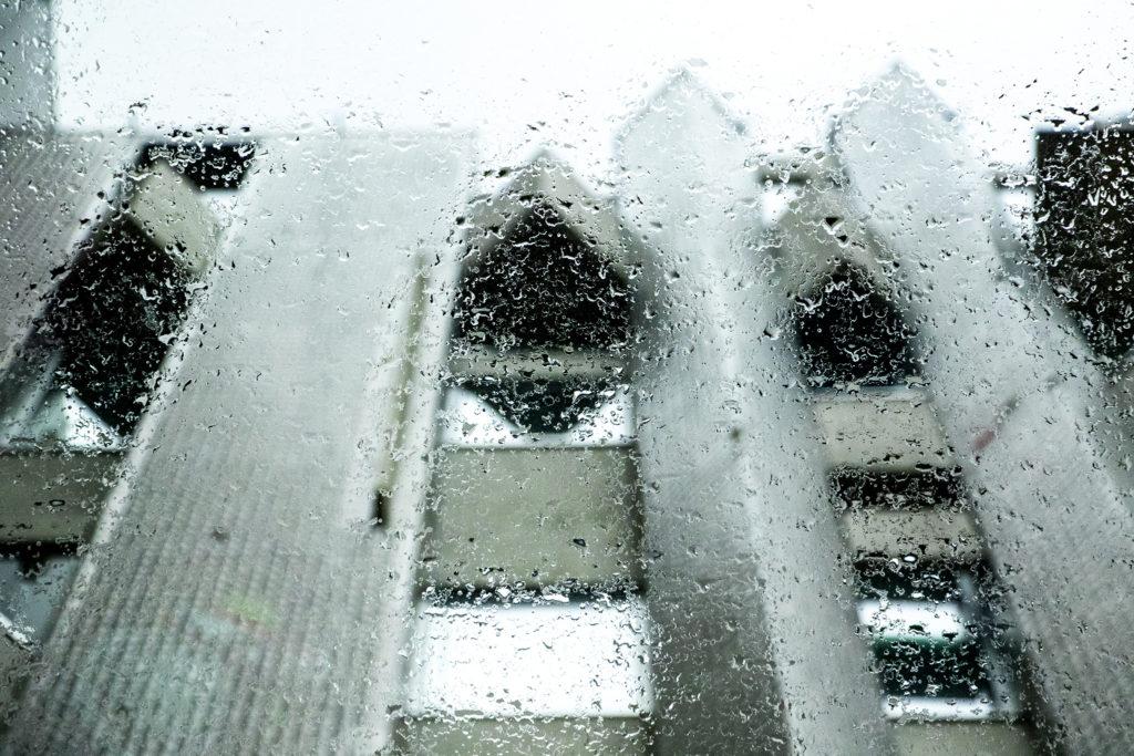 A view through rain-drizzled glass inside the Denver Art Museum's new campus, Aug. 8, 2019. (Kevin J. Beaty/Denverite)