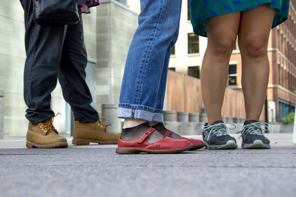 """An array of shoes you'll find at the Empathy Museum's traveling """"A Mile in My Shoes"""" exhibit, part of this year's Biennial of the Americas, Aug. 8, 2019. (Kevin J. Beaty/Denverite)"""