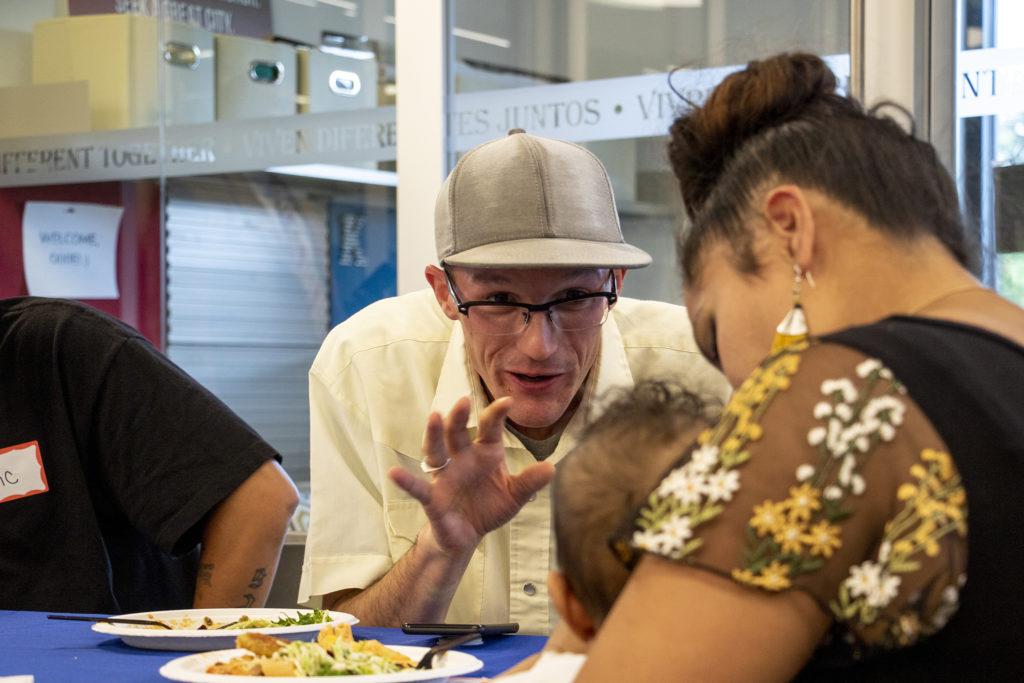 Joseph Camp smiles at baby Nasser during a CrossPurpose alumni dinner, Aug. 13, 2019. (Kevin J. Beaty/Denverite)