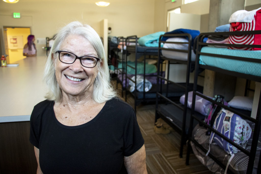 Julie Duffy, founding director of the Delores Project, poses for a portrait in the Delores Project's new dorms in Denver's West Colfax neighborhood, Aug. 19, 2019. (Kevin J. Beaty/Denverite)