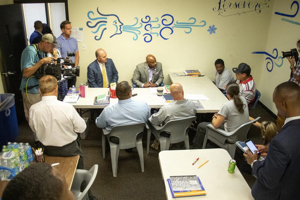 Mayor Michael Hancock meets with inmates living in CoreCivic's 90-day addiction treatment halfway house facility. Aug. 20, 2019. (Kevin J. Beaty/Denverite)