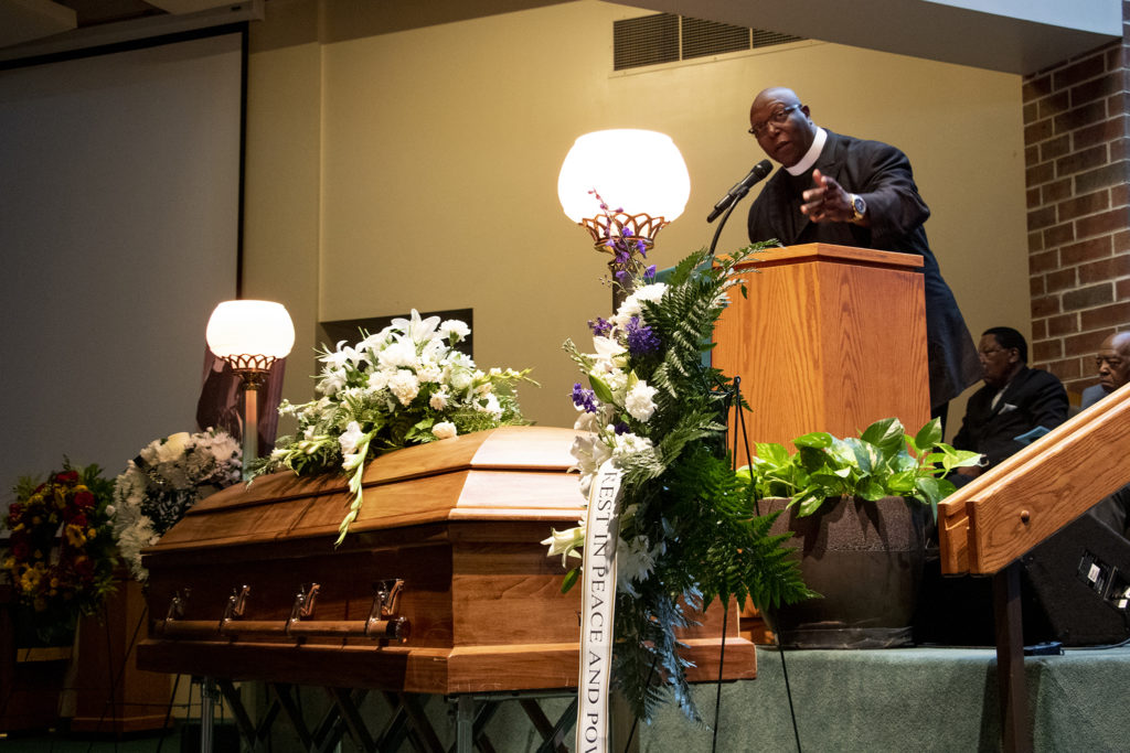 Pastor Terrence Hughes speaks during a funeral for Lauren Watson, founder of Colorado's Black Panther Party, Aug. 21, 2019. (Kevin J. Beaty/Denverite)