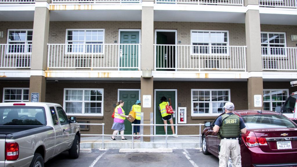 Volunteers canvass a Lakewood motel during a count of the unhoused in Jefferson County, Aug. 21, 2019. (Kevin J. Beaty/Denverite)