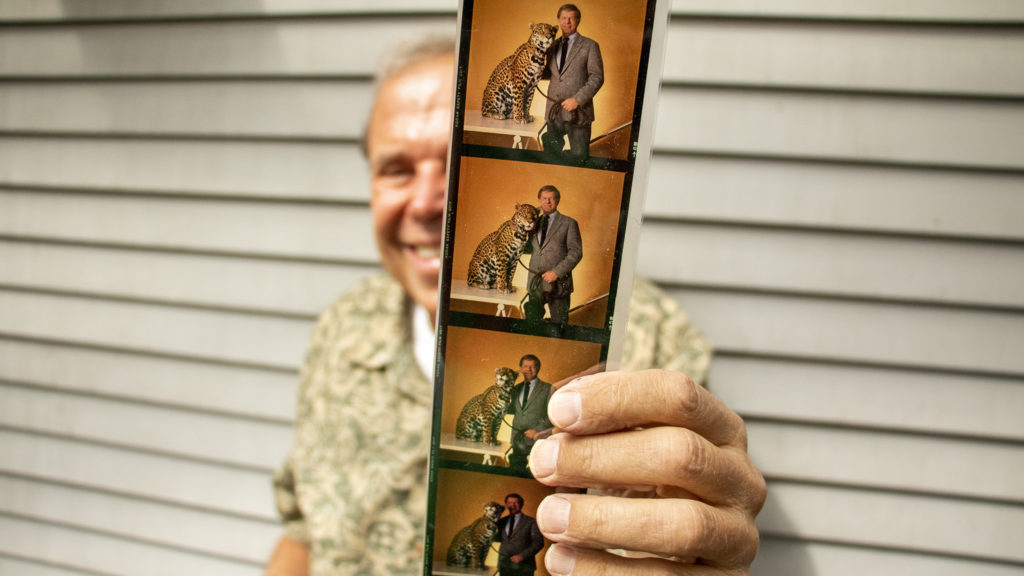 Mark Kiryluk shows out-takes from his cover shoot of Red Miller for Denver Magazine. Aug. 26, 2019. (Kevin J. Beaty/Denverite)