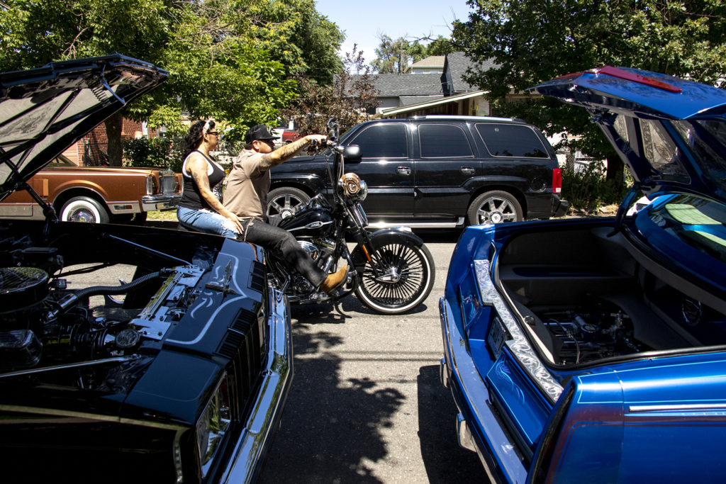 Motorcyclists circle around La Raza (or Columbus) Park before a cruise down Federal Boulevard. Aug. 25, 2019. (Kevin J. Beaty/Denverite)