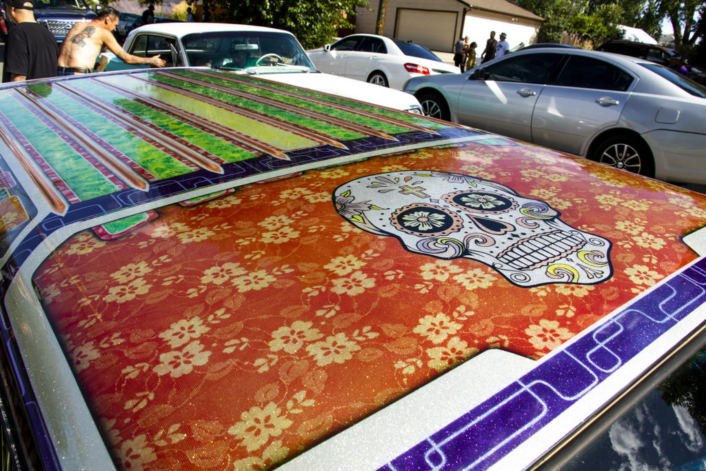 The low rider Marlene Swazo's husband built for her at Barnum Park, after a cruise down Federal Boulevard. Aug. 25, 2019. (Kevin J. Beaty/Denverite)