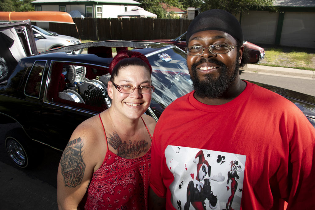 Rovance Taylor and Desiree Christian pose for a portrait at Barnum Park after a cruise down Federal Boulevard. Aug. 25, 2019. (Kevin J. Beaty/Denverite)