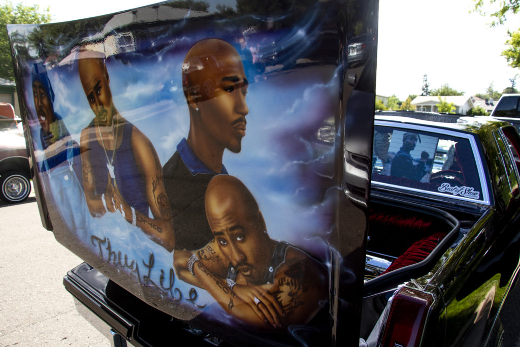 Sam Henry and Gina Armijo's low rider is parked at Barnum Park after a cruise down Federal Boulevard. Aug. 25, 2019. (Kevin J. Beaty/Denverite)