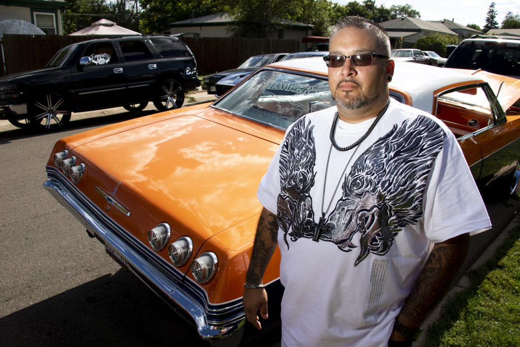 Mikey Bartolo and his Denver-themed low rider at Barnum Park after a cruise down Federal Boulevard. Aug. 25, 2019. (Kevin J. Beaty/Denverite)