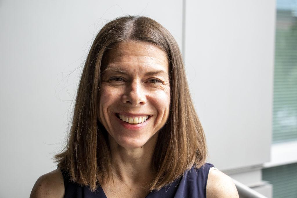 Christy Collins, head of Denver's green building ordinance program, poses for a portrait. Aug. 29, 2019. (Kevin J. Beaty/Denverite)