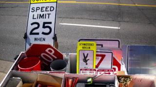 Denver Public Works replaces a speed limit sign, with a lower limit, on Evans Avenue. Aug. 30, 2019. (Kevin J. Beaty/Denverite)