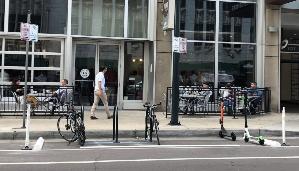 A bike corral in front of Novo Coffee downtown. (David Sachs/Denverite)