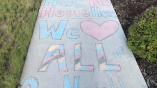 Positive messages drawn in chalk near an area where racist graffiti was found at Prairie Meadows Park in Stapleton last week. (Courtesy Melissa West)