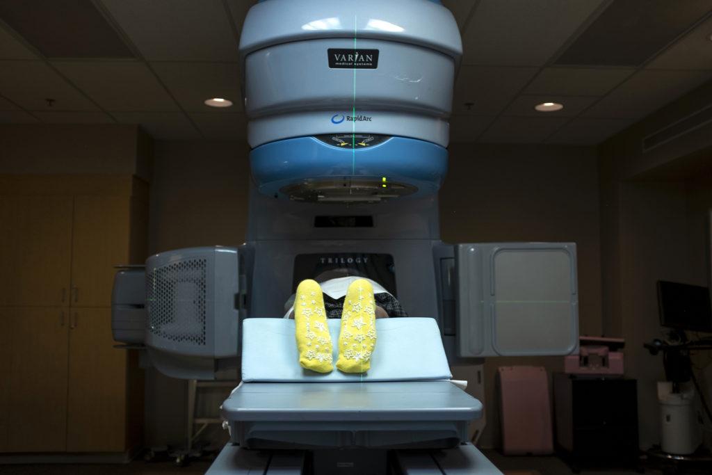 Armando Peniche-Cruz lies in a St. Joseph Hospital radiation suite for treatment. July 18, 2019. (Kevin J. Beaty/Denverite)