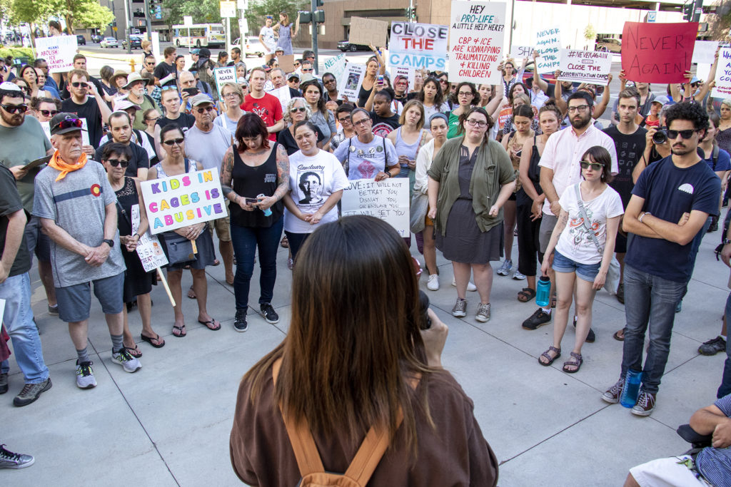 Laura Peniche speaks at a protest for immigrants rights outside of the Byron Rogers Federal Building downtown, July 18, 2019. (Kevin J. Beaty/Denverite)