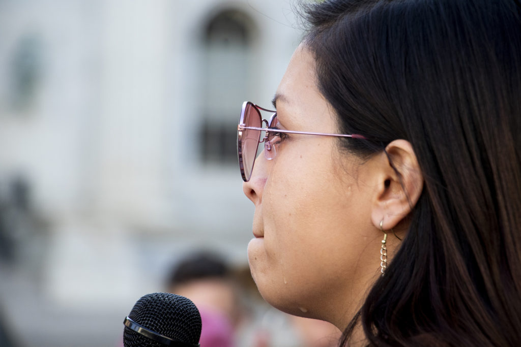 Tears stream down Laura Peniche's face as she speaks at a protest for immigrants rights outside of the Byron Rogers Federal Building downtown, July 18, 2019. (Kevin J. Beaty/Denverite)