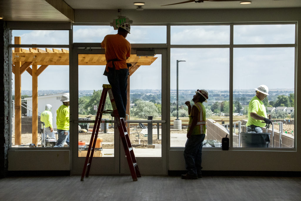 Construction finishes up on Crossing Pointe North in Thornton, Sept. 3, 2019. (Kevin J. Beaty/Denverite)