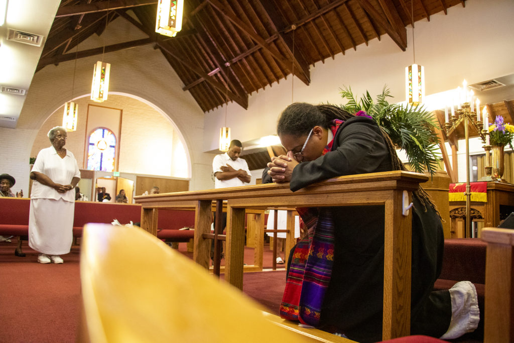 Rev. Jennifer S. Leath prays before her sermon at Campbell Chapel AME Church on a Sunday morning, Aug. 11, 2019. (Kevin J. Beaty/Denverite)