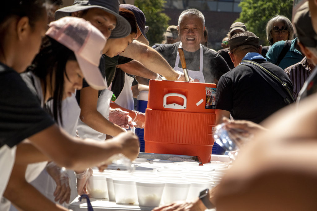 Sensei Gaku Homma leads a squad of Nepali soldiers as they feed unhoused Denverites on the Auraria campus, Aug. 18, 2019. (Kevin J. Beaty/Denverite)