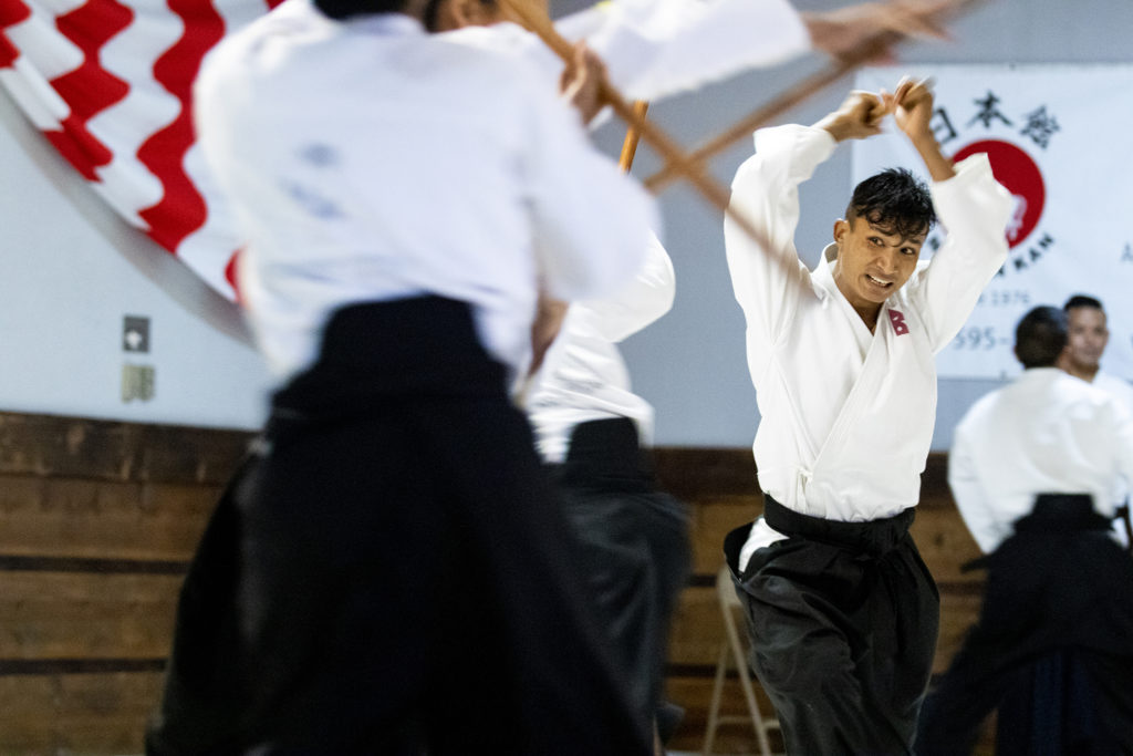 Dil Guru, a soldier in Nepal's army, demonstrates his skills at a ceremony closing out a month of training at Aikido Nippon Kan, Aug. 31, 2019. (Kevin J. Beaty/Denverite)