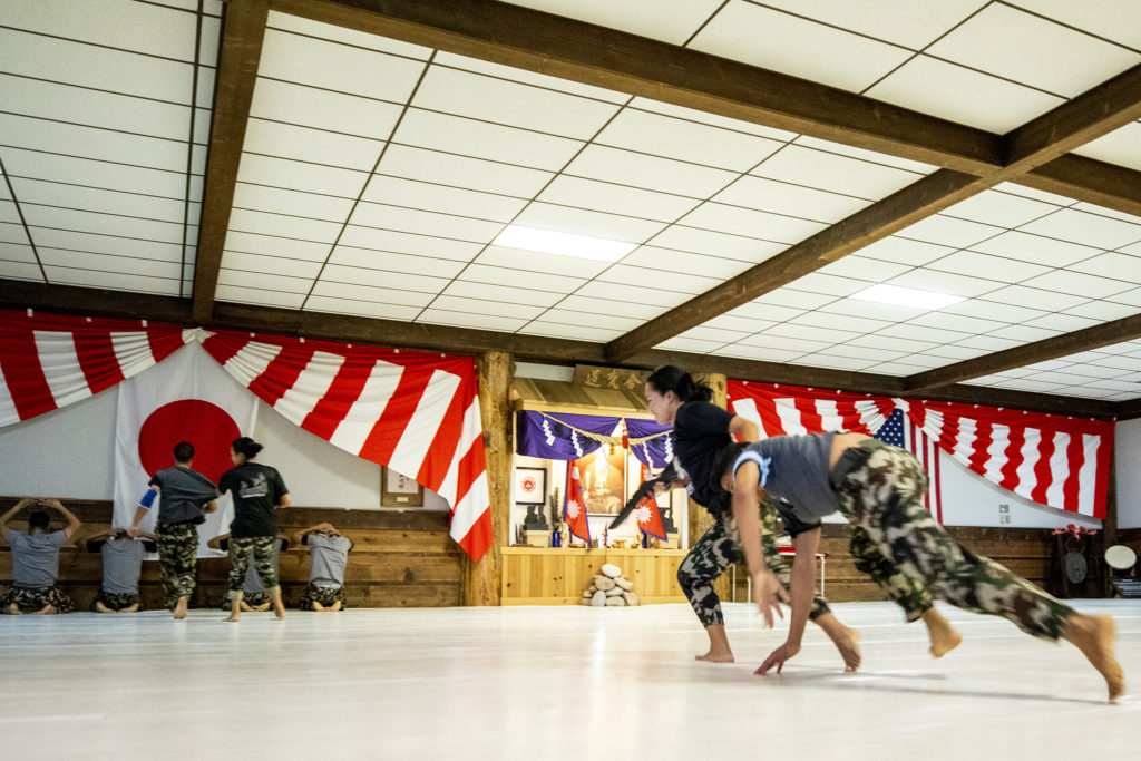 Nepali Soldiers demonstrate how they've learned to avoid lethal force at Aikido Nippon Kan during a ceremony celebrating a month of training, Aug. 31, 2019. (Kevin J. Beaty/Denverite)