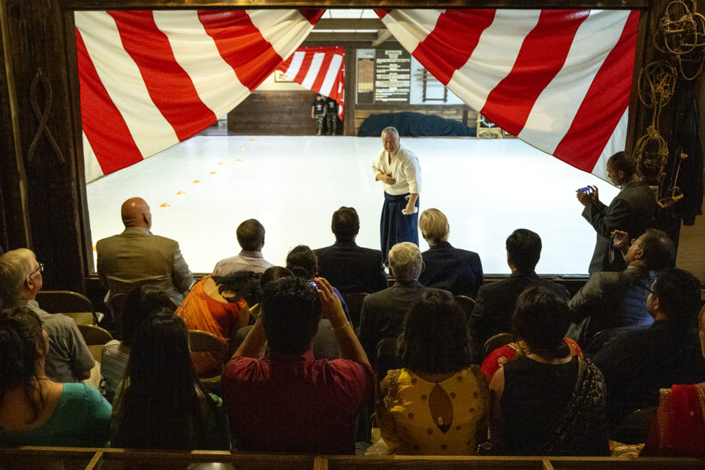 Sensei Gaku Homma addresses a crowd gathered to celebrate a month of training for Nepali soldiers at Aikido Nippon Kan, Aug. 31, 2019. (Kevin J. Beaty/Denverite)