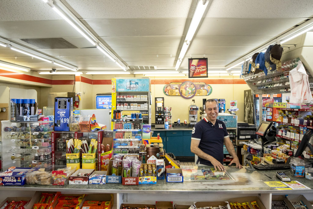 Khalid Housse on the job at the Moline Corner Store on Labor Day, Sept. 2, 2019. (Kevin J. Beaty/Denverite)