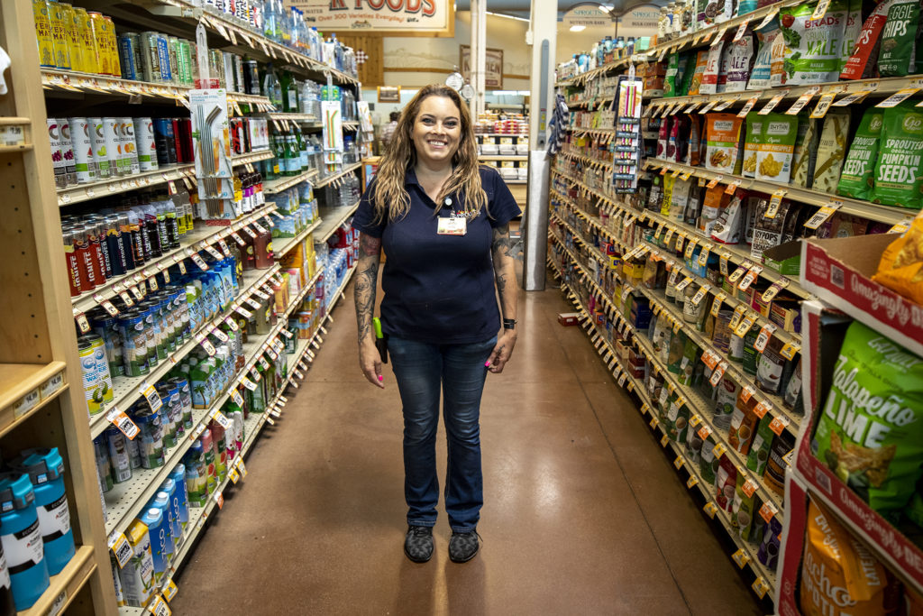 Jenn Kipp, a manager at Sprouts Farmers Market on Colfax Avenue, said she's worked holidays her whole career. She's fine with it. Labor Day, Sept. 2, 2019. (Kevin J. Beaty/Denverite)