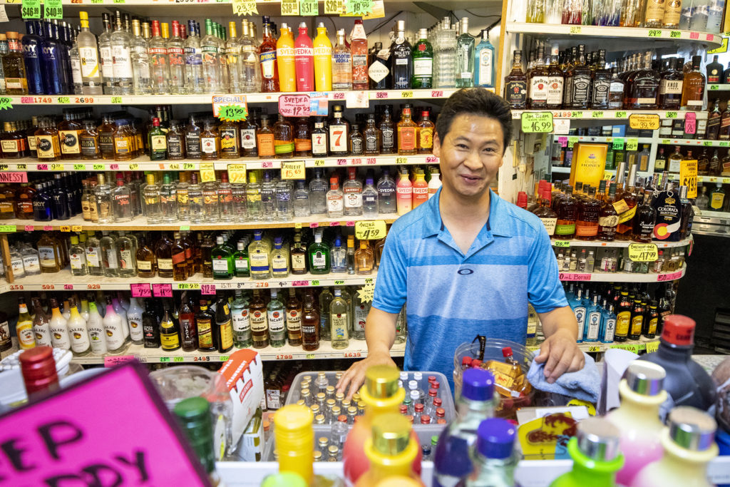 Jay Jung on the job at Scooter Liquors on Labor Day, Sept. 2, 2019. (Kevin J. Beaty/Denverite)