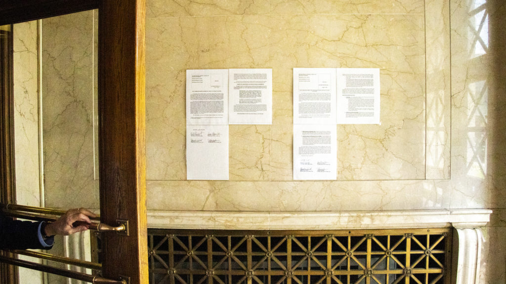 A court order posted in the entrance to the City and County Building stipulating appropriate conduct in certain chambers, Sept. 3, 2019. (Kevin J. Beaty/Denverite)