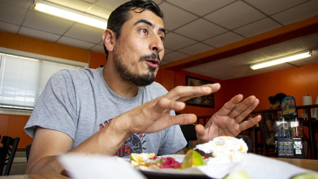 Chef Jose Avila eats tacos atLa Calle Taqueria y Carnitas on Alameda, one of his favorite spots. Sept. 10, 2019. (Kevin J. Beaty/Denverite)