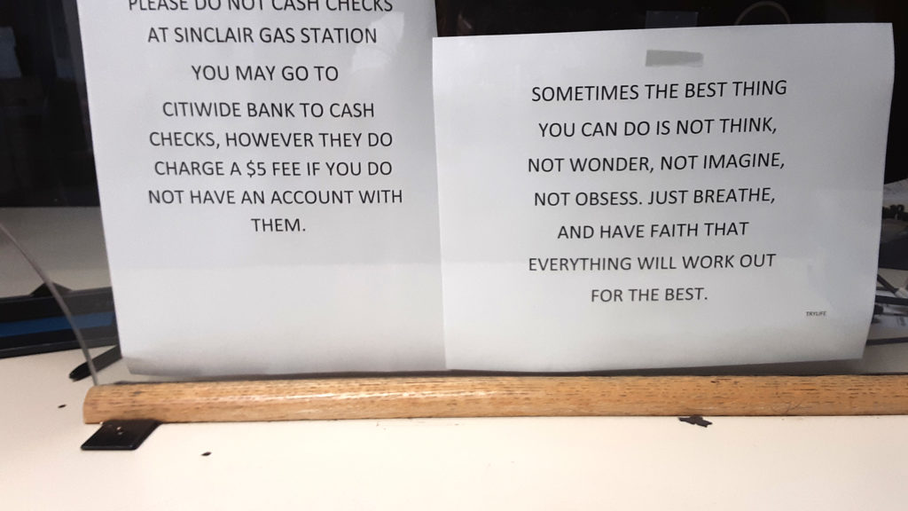 A photo of a sign warning women living at GEO's Williams Street halfway house not to cash checks at a nearby Sinclair gas station.