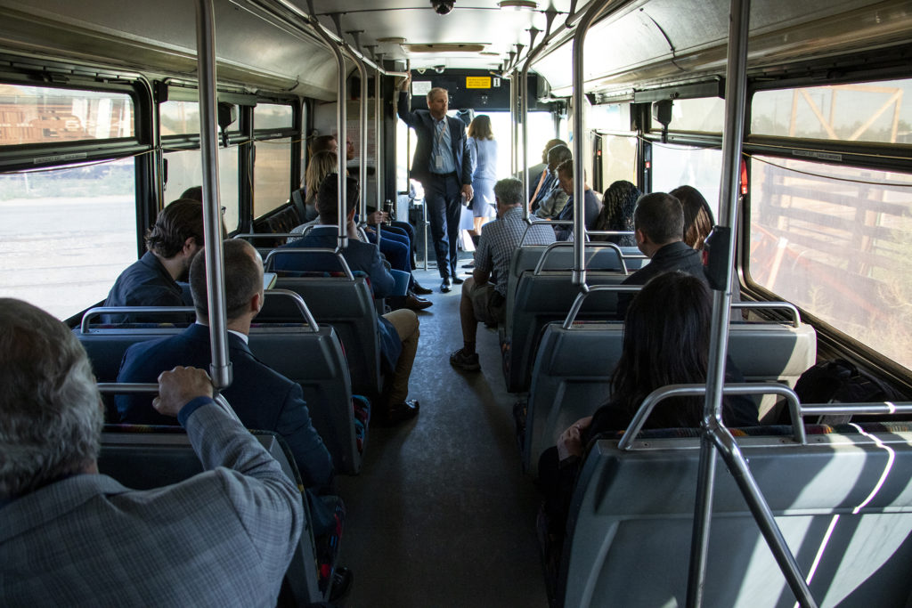 Patrick O'Keefe, program director for Jacobs, leads a tour of Globeville and Elyria Swansea for a delegation meeting with the White House Opportunity and Revitalization Council, Sept. 12, 2019. (Kevin J. Beaty/Denverite)