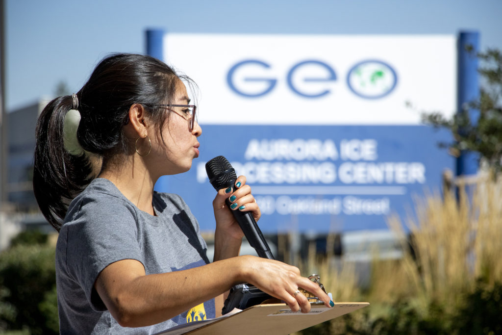 Ana Rodriguez, with the Colorado People's Alliance, leads a small protest outside of GEO's contract detention center in Aurora, Sept. 13, 2019. (Kevin J. Beaty/Denverite)