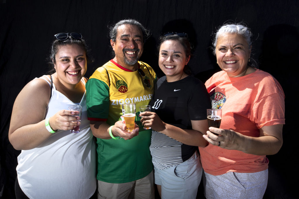 Lindsey, Adrian, Jessica and Alma Vargas. Suave Fest, by the future site of Raices Brewing, Sept. 14, 2019. (Kevin J. Beaty/Denverite)