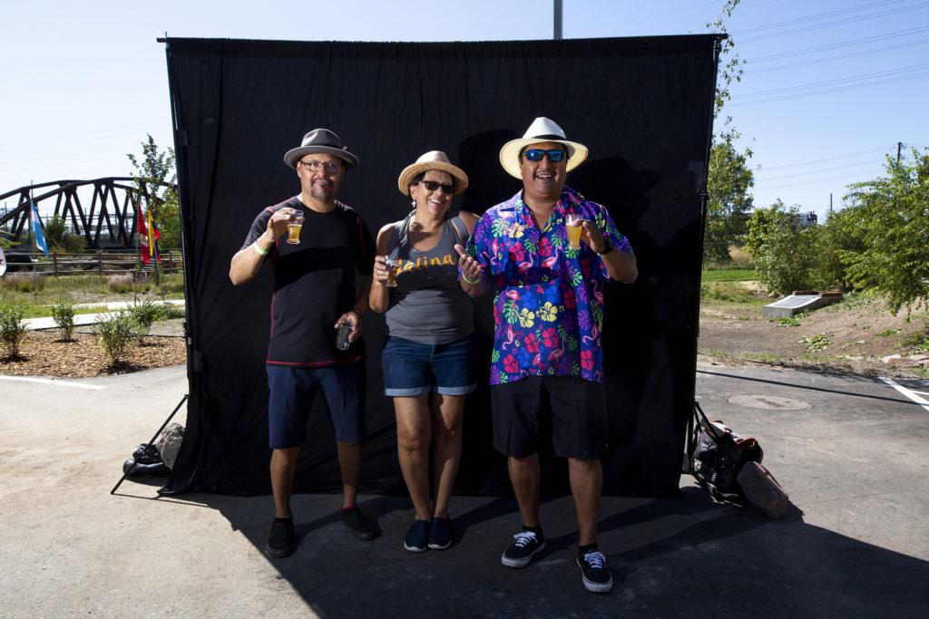 Manul Guzman, Yvonne Vigil and Fernando Guzman. Suave Fest, by the future site of Raices Brewing, Sept. 14, 2019. (Kevin J. Beaty/Denverite)