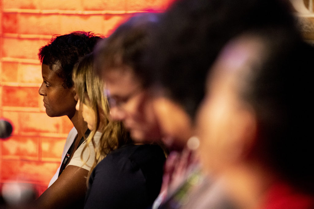 """Whittier Cafe owner Millete Birhanemaskel acts as a """"dolphin tank"""" judge during CrossPurpose's Change Agency pitch night, Sept. 18, 2019. (Kevin J. Beaty/Denverite)"""