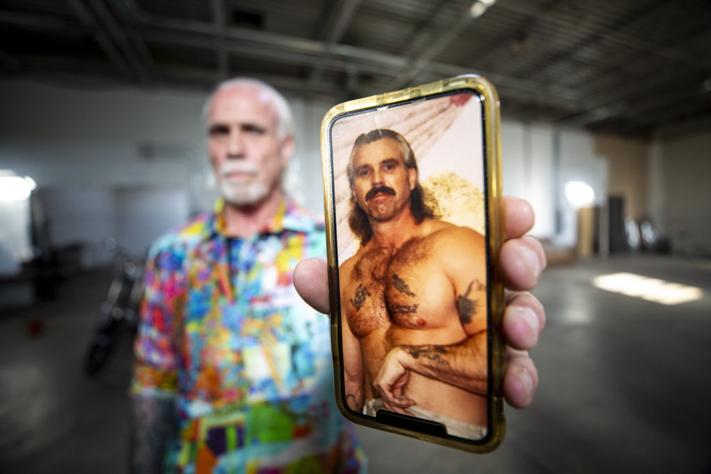"""""""Accidental developer"""" Bernard Hurley shows a photo of what he looked like before he went to prison. Sept. 24, 2019. (Kevin J. Beaty/Denverite)"""