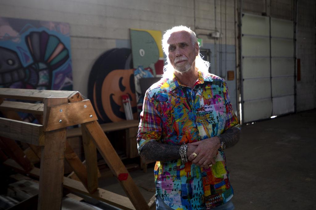 """Accidental developer"" Bernard Hurley speaks to a reporter inside his warehouse on Chestnut Place, a few blocks off Brighton Boulevard. Sept. 24, 2019. (Kevin J. Beaty/Denverite)"