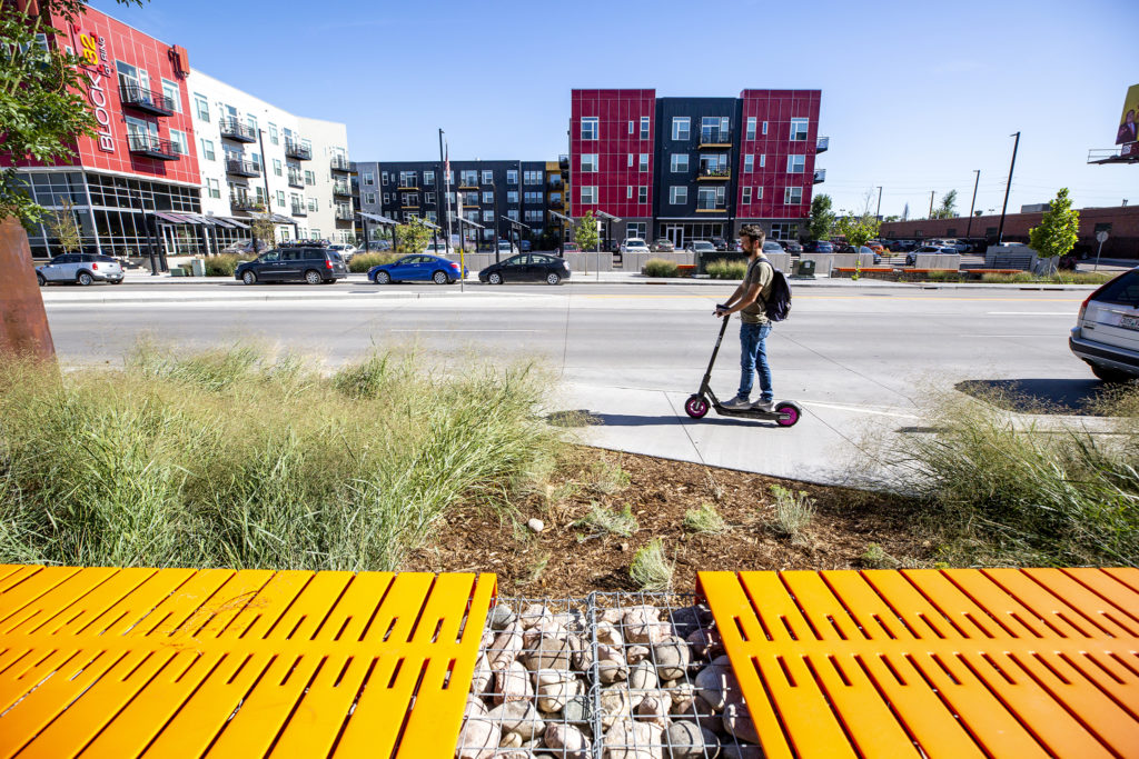 A scooterer rides along Brighton Boulevard, Five Points, Sept. 24, 2019. (Kevin J. Beaty/Denverite)
