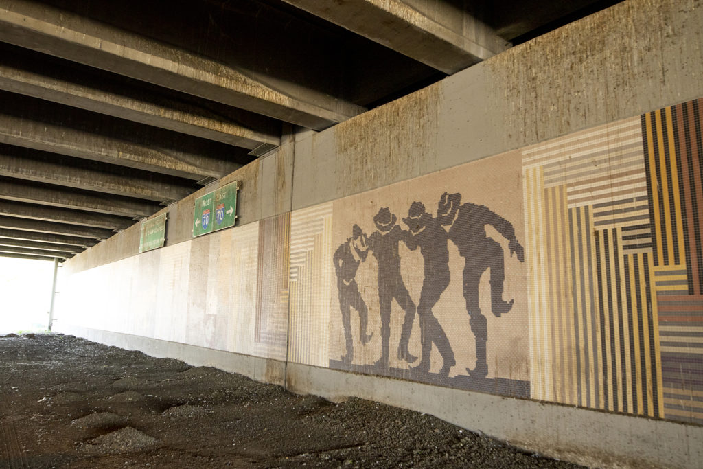 Cow polk depicted in a mural by a seemingly unknown artist beneath the I-70 viaduct near Brighton Boulevard, Elyria Swansea, Sept. 30, 2019. (Kevin J. Beaty/Denverite)