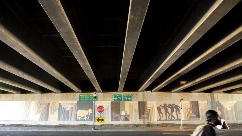 A mural by a seemingly unknown artist beneath the I-70 viaduct near Brighton Boulevard, Elyria Swansea, Sept. 30, 2019. (Kevin J. Beaty/Denverite)
