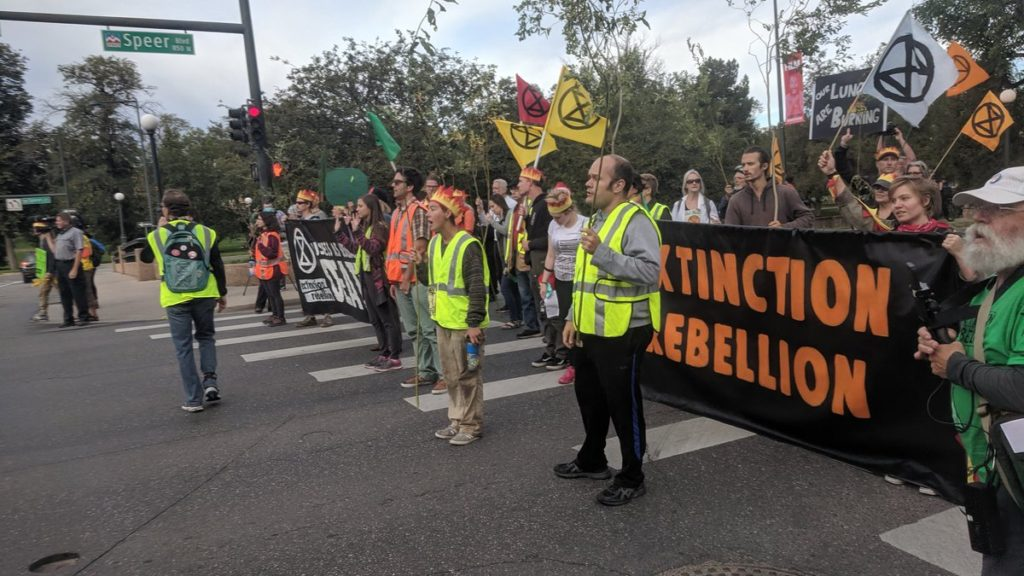 Protesters with Extinction Rebellion Denver block Spear Boulevard, Monday September 23, 2019. (Sam Brasch/CPR News)