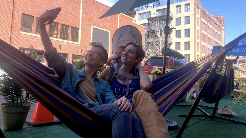 Fonia Barwick and Mandy Owen chill outside Milk Market at 18th and Wazee streets. (David Sachs/Denverite)