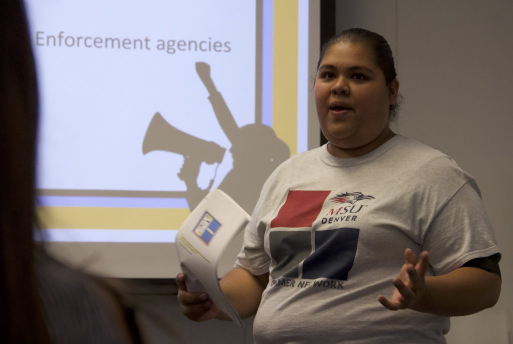 """Ariadna Ochoa Magallanes leads a """"Know Your Rights"""" discussion on Thursday, Sept. 26, 2019, at Metro State University in Denver. (Esteban L. Hernandez/Denverite)"""