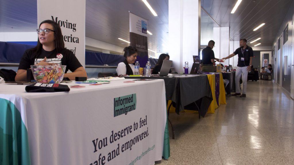 Tables set up with information on immigrant resources during a fair at Metro State University on Thursday, Sept. 26, 2019, in Denver. (Esteban L. Hernandez/Denverite)